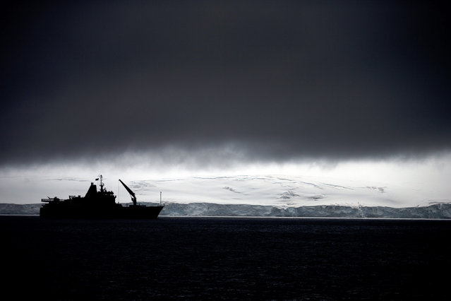 In this January 25, 2015 photo, Chile's Navy ship Aquiles moves alongside the Hurd Peninsula, seen from Livingston Islands, part of the South Shetland Islands archipelago in Antarctica. This is also the place where a hole in the ozone layer, from man-made refrigerants and aerosols, parks for a couple months when sunlight creeps back to Antarctica in August. It triggers a chemical reaction that destroys ozone molecules, causing a hole that peaks in September and then closes with warmer weather in November. (Photo by Natacha Pisarenko/AP Photo)