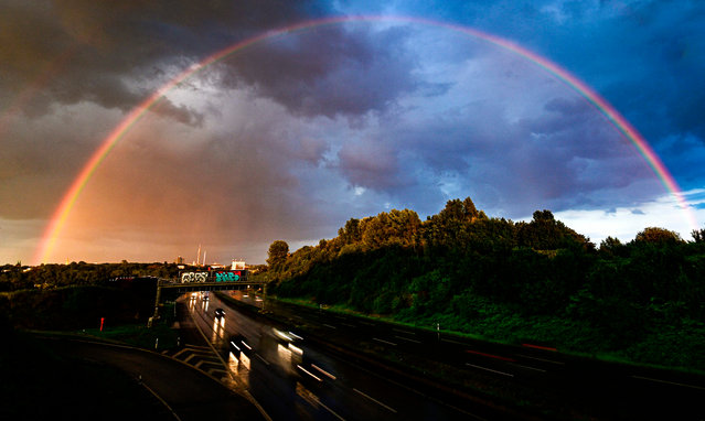 A rainbow and dark clouds are seen over the city of Dortmund, western Germany on July 26, 2020. (Photo by Ina Fassbender/AFP Photo)