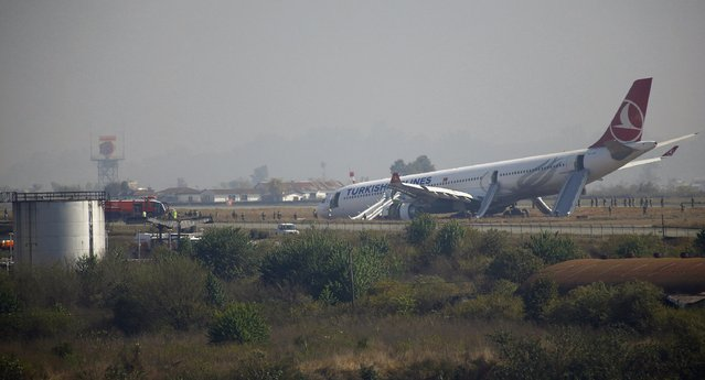 A Turkish Airlines plane lies on the field after it overshot the runway at Tribhuvan International Airport in Kathmandu March 4, 2015. According to local media  all passengers were rescued.  REUTERS/Navesh Chitrakar