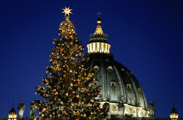 The Vatican Christmas tree is lit up during a ceremony in Saint Peter's Square at the Vatican December 9, 2016. (Photo by Alessandro Bianchi/Reuters)