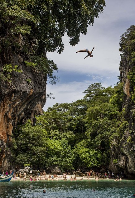 In this handout image provided by Red Bull, Gary Hunt of the UK dives from the 27 metre platform on Hong Island in the Andaman Sea during the last competition day of the eighth and final stop of the 2013 Red Bull Cliff Diving World Series on October 26, 2013 at Krabi, Thailand. (Photo by Romina Amato/Red Bull via Getty Images)