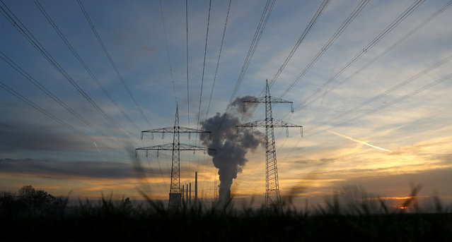 Genreal view of electricity pylons and power lines leading from the Uniper coal power plant in Hanau, Germany, early morning November 23, 2016. (Photo by Kai Pfaffenbach/Reuters)