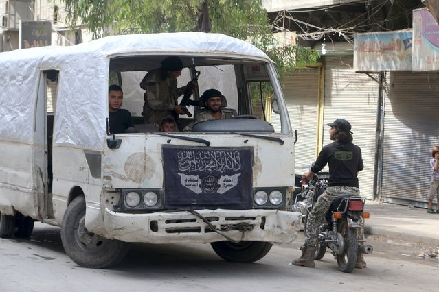 Free Syria Army fighters ride a bus in Aleppo, Syria October 2, 2015. (Photo by Abdalrhman Ismail/Reuters)