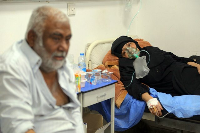 Coronavirus patients receive treatment at a hospital in Najaf, Iraq, Wednesday, July 14, 2021. Infections in Iraq have surged to record highs amid a third wave spurred by the more aggressive delta variant, and long-neglected hospitals suffering the effects of decades of war are overwhelmed with severely ill patients. (Photo by Anmar Khalil/AP Photo)