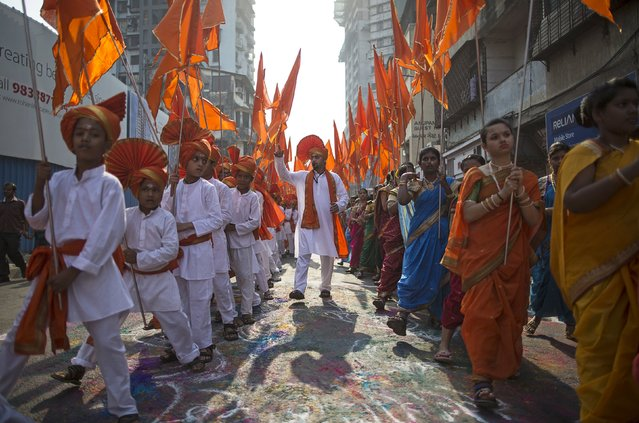 Maharashtrians dressed in traditional costumes attend celebrations to mark the Gudi Padwa festival in Mumbai March 21, 2015. (Photo by Danish Siddiqui/Reuters)