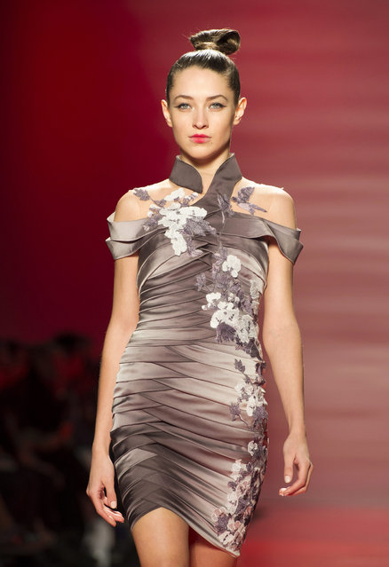 A model walks the runway in the Mikael D show during Toronto fashion week in Toronto on Friday, March 27, 2015. (Photo by Frank Gunn/AP Photo/The Canadian Press)