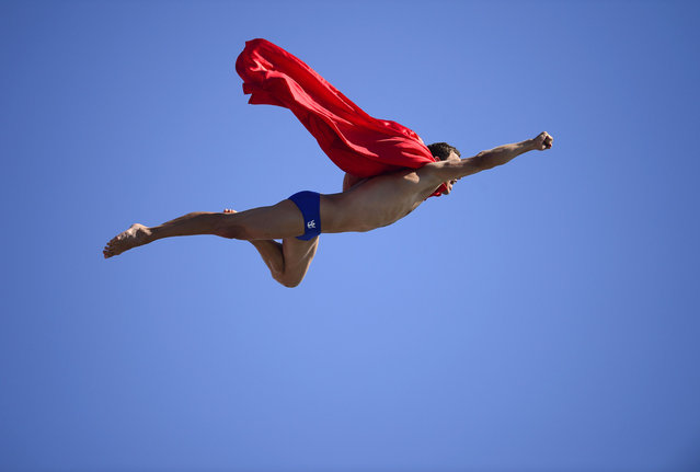 Czech Michal Navratil dives for a joke as superman after of the men's high diving final competition at the FINA World Championships in Moll de la Fusta port in Barcelona on July 31, 2013. (Photo by Javier Soriano/AFP Photo)
