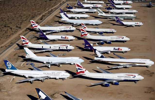 Old airplanes, including British Airways and Air New Zealand Boeing 747-400s, are stored in the desert in Victorville, California March 13, 2015. (Photo by Lucy Nicholson/Reuters)