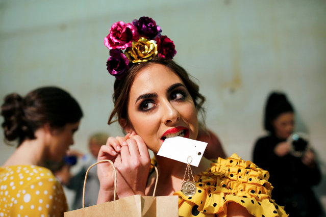 A model wears a creation by Inmaculada Martinez on the backstage, during the International Flamenco Fashion Show SIMOF in the Andalusian capital of Seville, Spain February 8, 2019. (Photo by Marcelo del Pozo/Reuters)