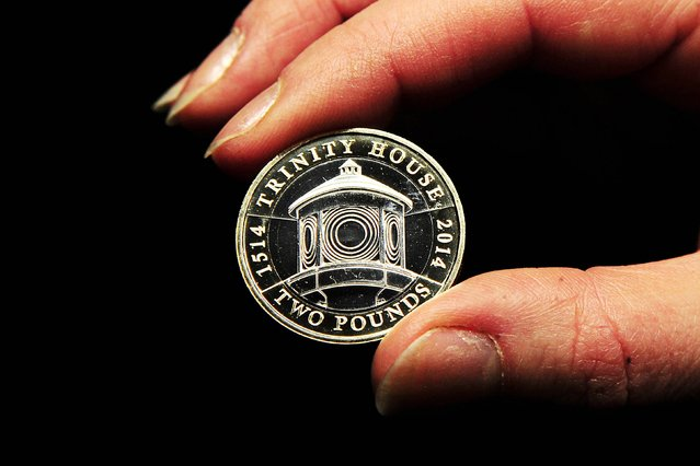 A new £2 coin featuring Trinity House which will go into circulation on 1st January 2014 at the Royal Mint in Pontyclun, Wales. Five new coin designs will enter circulation in 2014 to commemorate historic events including the First World War and the Commonwealth Games. (Photo by Joe Giddens/PA Wire)