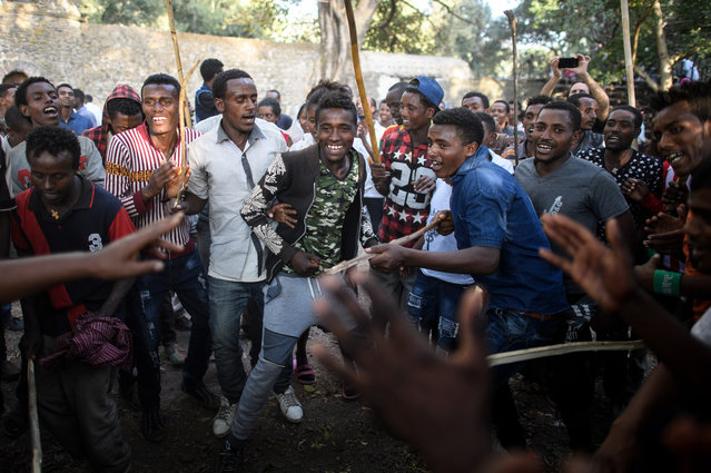 Young men sing and dance during the annual Timkat epiphany celebration on January 18, 2017 in Gondar, Ethiopia. (Photo by Carl Court/Getty Images)