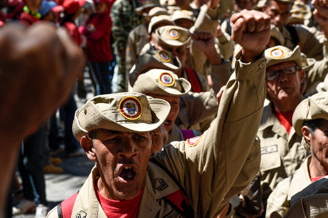 "Members of Venezuela's Bolivarian militia demonstrate in support of President Nicolas Maduro during a commemoration for the ""27th Anniversary of the Military Rebellion of the 4FEB92 and National Dignity Day"", at Bolivar Square in Caracas, on February 4, 2019. The United Nations will not join any group of nations promoting initiatives to resolve the crisis in Venezuela, the UN chief said Monday, indicating he will not attend a meeting in Uruguay this week of several countries. Mexico and Uruguay had hoped that UN Secretary-General Antonio Guterres would attend a conference in Montevideo on Thursday aimed at promoting dialogue between Venezuela's President Nicolas Maduro and opposition leader Juan Guaido. (Photo by Federico Parra/AFP Photo)"