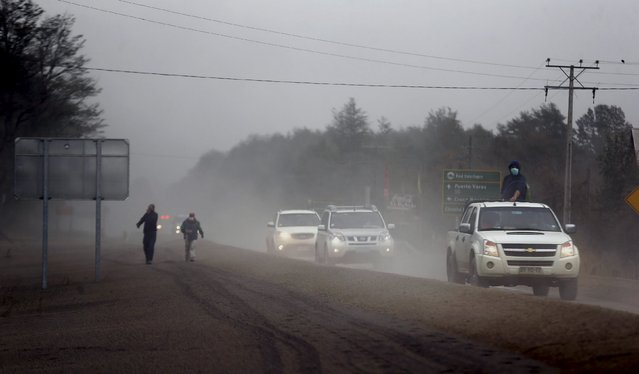 Vehicles travel along a road at Ensenada town which is covered with ashes from Calbuco volcano near Puerto Varas city, April 23, 2015. (Photo by Ivan Alvarado/Reuters)