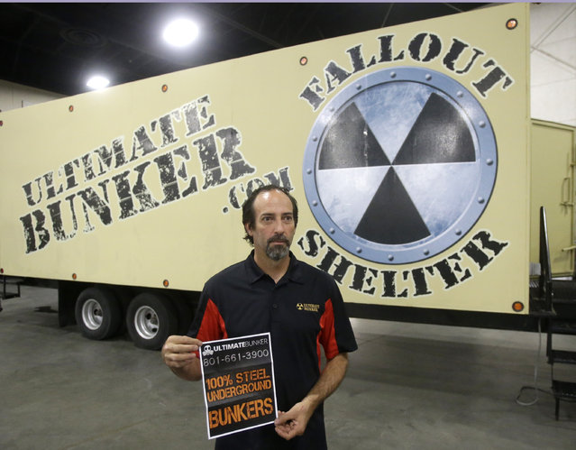 Mike Peters, with Ultimate Bunker stands in front of a 100% steel underground bunker during the PrepperCon expo Friday, April 24, 2015, in Sandy, Utah. (Photo by Rick Bowmer/AP Photo)