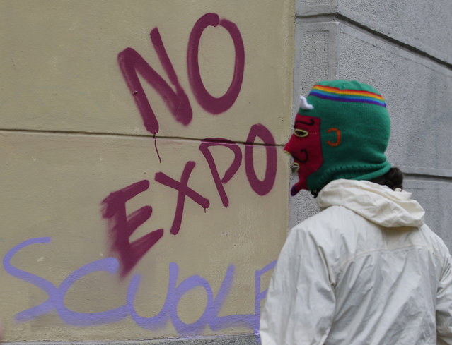 A demonstrator attends a protest against Expo 2015 in Milan, Italy, Thursday, April 30, 2015. (Photo by Antonio Calanni/AP Photo)