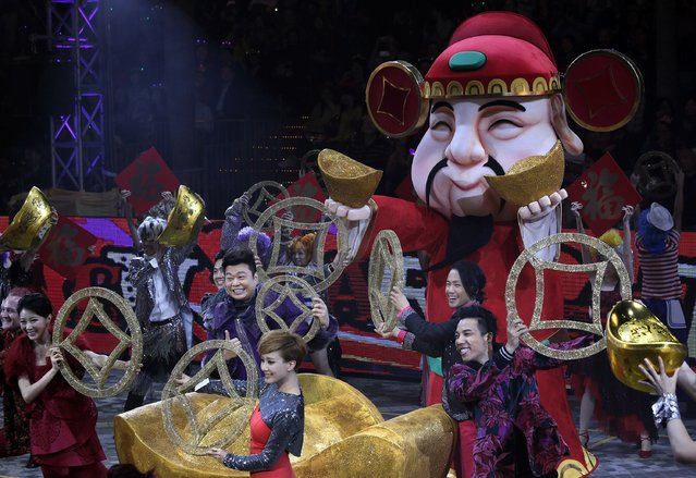 Performers take part in a night parade to celebrate Chinese New Year in Hong Kong, Friday, January 31, 2014. The Lunar New Year this year marks the Year of the Horse in the Chinese calendar. (Photo by Vincent Yu/AP Photo)