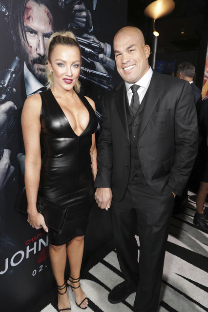 """Amber Nicole Miller and Tito Ortiz seen at Summit Entertainment, a Lionsgate Company, Los Angeles Premiere of """"John Wick Chapter 2"""" at ArcLight Hollywood on Monday, January 30, 2017, in Los Angeles. (Photo by Eric Charbonneau/Invision for Lionsgate/AP Images)"""