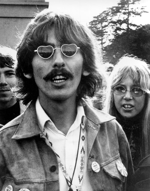 Member of the British rock and roll band The Beatles George Harrison, wearing heart-shaped sunglasses, is shown with his wife, Patti Boyd, in San Francisco, Ca., August 8, 1967. (Photo by AP Photo)
