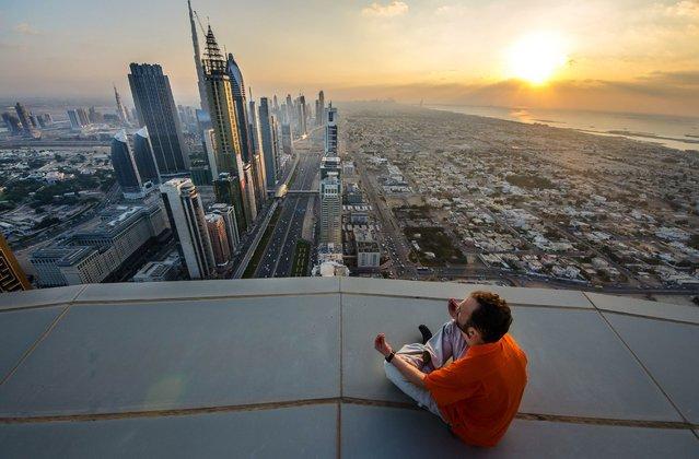 One of Yaroslav Segeda's friends on top of a tall building in Kiev. (Photo by Yaroslav Segeda/Solent News)