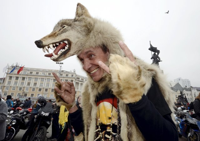 A participant wearing a wolf skin poses for a picture as he attends a gathering to celebrate the opening of a new bikers' season in the Russian far eastern city of Vladivostok, May 2, 2015. (Photo by Yuri Maltsev/Reuters)