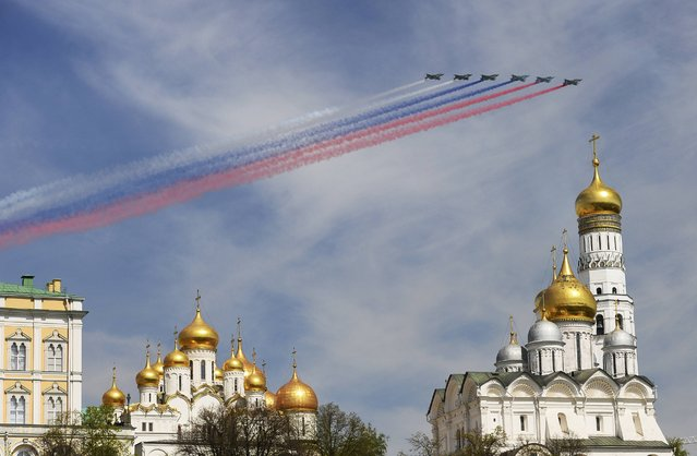Russian Sukhoi Su-25 Frogfoot ground-attack planes fly in formation over the Red Square during the Victory Day parade in Moscow, Russia, May 9, 2015. (Photo by Reuters/Host Photo Agency/RIA Novosti)