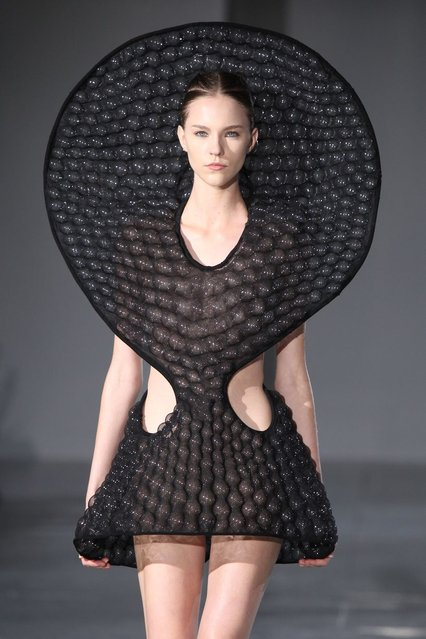 A model walks the runway during the Iris Van Herpen show as part of the Paris Fashion Week Womenswear Fall/Winter 2014-2015 on March 4, 2014 in Paris, France. (Photo by Antonio de Moraes Barros Filho/WireImage)