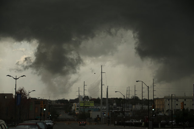 A tornadic storm passes over north Tulsa on Wednesday, March 30,2016. The National Weather Service is confirming multiple tornado touchdowns in the Tulsa, Okla., area. Meteorologist Amy Jankowski says a storm that swept across the area Wednesday night led to a tornado that touched down and lifted up numerous times. (Photo by James Gibbard/Tulsa World via AP Photo)