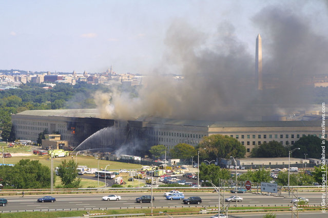 Smoke comes out from the west wing of the Pentagon building September 11, 2001 in Arlington, Va., after a plane crashed into the building and set off a huge explosion