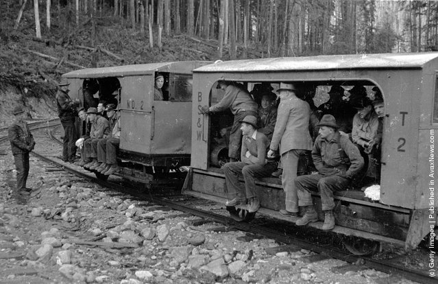 1940: Loggers employed at Messrs Bloedel, Stewart and Welch's logging operation in British Columbia travelling to work on the railway known as The Speeder