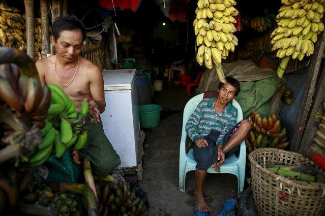 Men sell bananas at a banana market in Yangon April 29, 2015. (Photo by Soe Zeya Tun/Reuters)