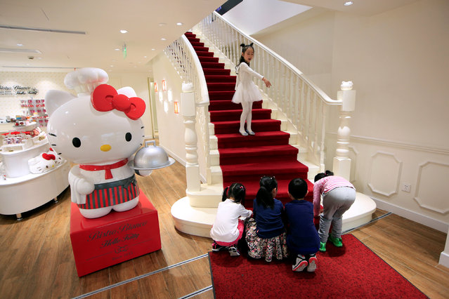 Children play inside China's first official Hello Kitty restaurant in Shanghai, China, April 9, 2016. Mainland China's first official Hello Kitty-themed restaurant has opened its doors to customers in Shanghai, serving a variety of food with the famed kitten character's designs. Hello Kitty Bistro Bianco comes after the opening of Hong Kong's official Hello Kitty restaurant last year and the Hello Kitty theme park in Zhejiang province. (Photo by Aly Song/Reuters)