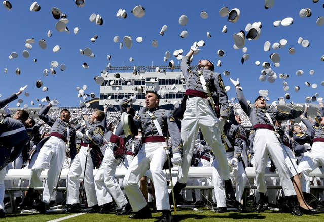 Graduates from the U.S. Military Academy toss their hats into the air after a graduation and commissioning ceremony on Saturday, May 23, 2015, in West Point, N.Y. (Photo by Mike Groll/AP Photo)