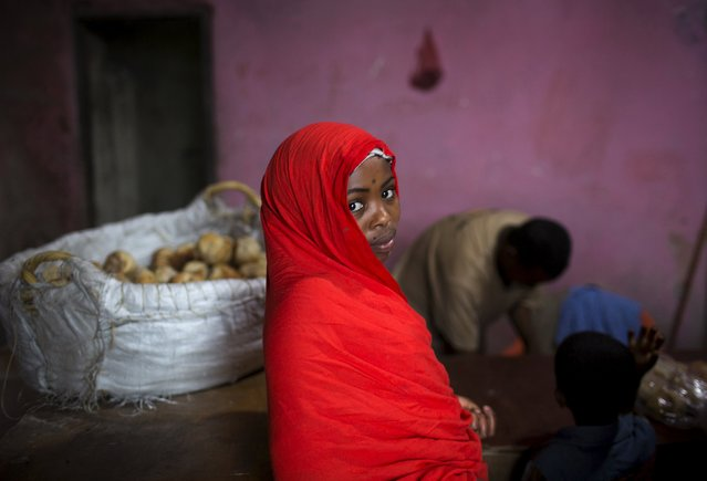 A girl is seen in a bakery in the old walled town of Harar in eastern Ethiopia, May 19, 2015. (Photo by Siegfried Modola/Reuters)