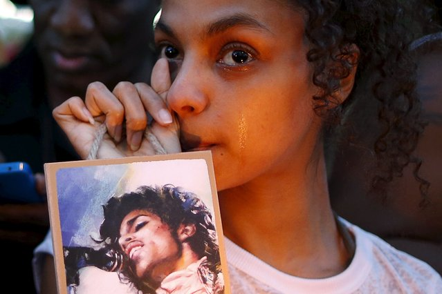 Julya Baer, 30, cries at a vigil to celebrate the life and music of deceased musician Prince in Los Angeles, California, U.S., April 21, 2016. (Photo by Lucy Nicholson/Reuters)