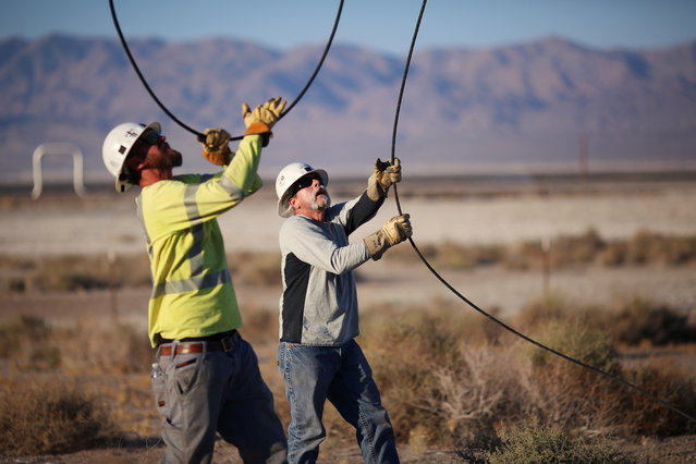 Linemen repair lines that were broken during a powerful earthquake that struck Southern California, near the epicenter, northeast the city of Ridgecrest, California, U.S., July 4, 2019. (Photo by David McNew/Reuters)