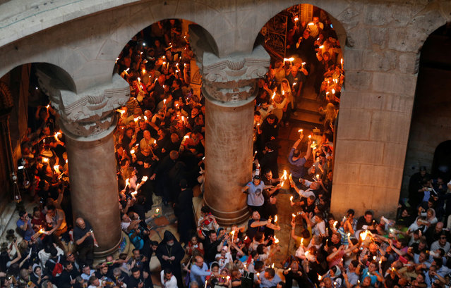 Worshippers hold candles as they take part in the Christian Orthodox Holy Fire ceremony at the Church of the Holy Sepulchre in Jerusalem's Old City April 30, 2016. (Photo by Ammar Awad/Reuters)