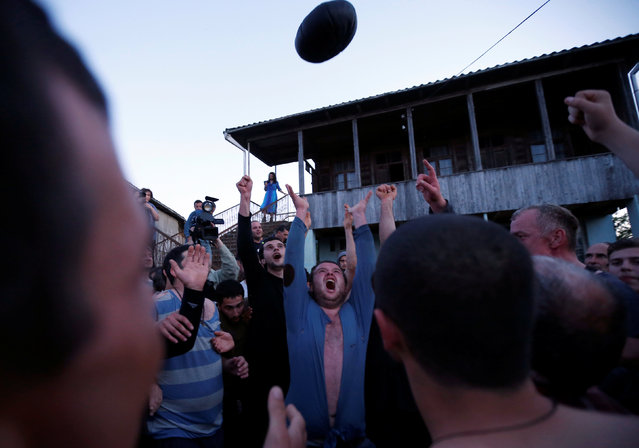 Winners celebrate after the annual Lelo match in the village of Shukhuti, Georgia, May 1, 2016. (Photo by David Mdzinarishvili/Reuters)