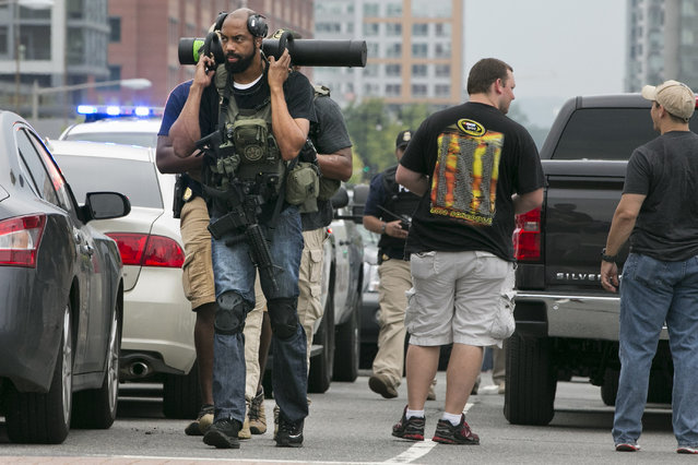 U.S. Marshall's walk near the Navy Yard in Washington, Thursday, July 2, 2015. A lockdown was underway Thursday morning across the Washington Navy Yard campus after reports of shots fired, but a senior law enforcement official said those reports had not been confirmed. (Photo by Jacquelyn Martin/AP Photo)