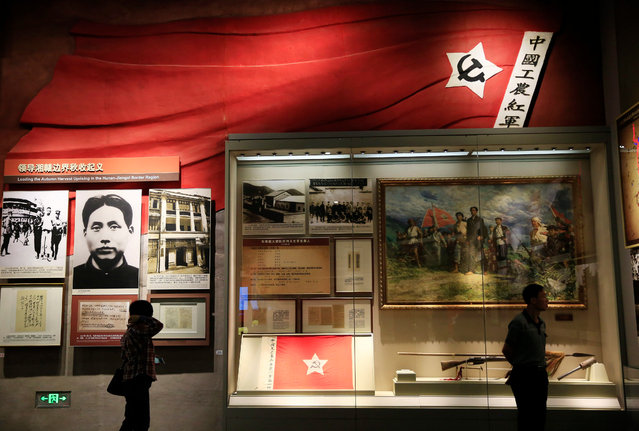 Visitors look at exhibits at the Shaoshan Mao Zedong Memorial Museum, in Shaoshan, Hunan Province in central China, 28 April 2016. (Photo by How Hwee Young/EPA)