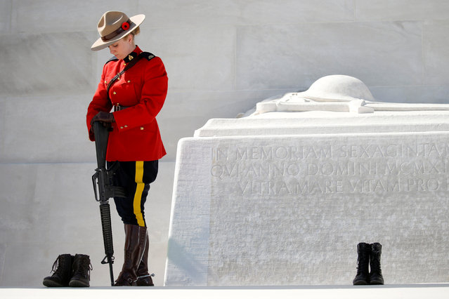 A Canadian police mounted officer stands guard before the ceremony to commemorate the 100th anniversary of the battle of Vimy Ridge, at Canadian National Memorial in Vimy, France, April 9, 2017. (Photo by Pascal Rossignol/Reuters)