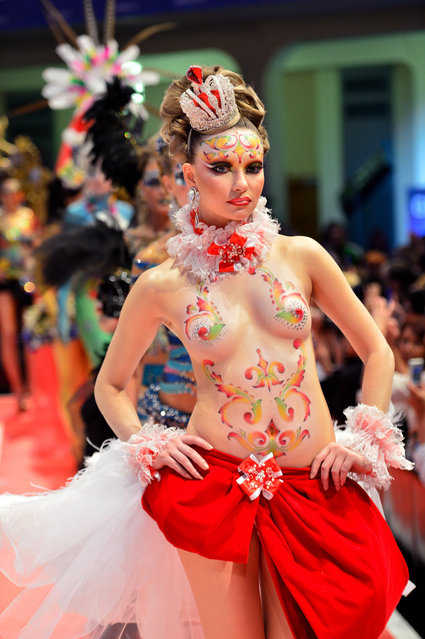 "A model poses on the catwalk after the contest ""Body Painting"" of the OMC Hairworld World Cup on May 4, 2014 in Frankfurt am Main, Germany. The OMC Hairworld World Cup will be held in Frankfurt from 3 to 5 May 2014, parallel to the Hair and Beauty 2014 fair. Around 1.250 participants from 50 countries fight in different contest for the titles. (Photo by Thomas Lohnes/Getty Images)"