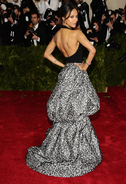 "Zoe Saldana attends The Metropolitan Museum of Art's Costume Institute benefit gala celebrating ""Charles James: Beyond Fashion"" on Monday, May 5, 2014, in New York. (Photo by Charles Sykes/Invision/AP Photo)"