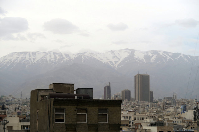 A view shows Tehran's skyline with snow-covered mountains in the background, Iran May 2, 2016. (Photo by Marius Bosch/Reuters)