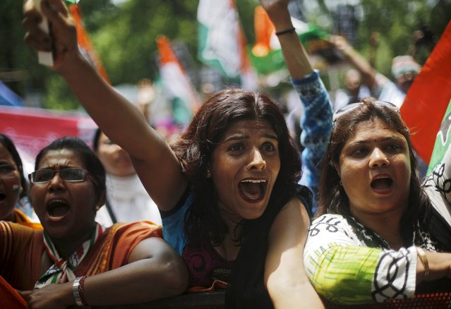 Members the All India Mahila Congress, the women's wing of the Congress party, shout slogans during a protest against Indian Prime Minister Narendra Modi in New Delhi, India, July 21, 2015. (Photo by Adnan Abidi/Reuters)