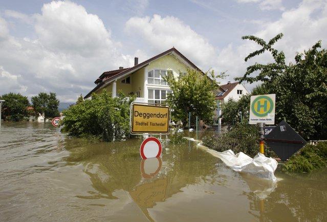 The village of Fischerdorf, near Deggendorf, is flooded, June 7, 2013. REUTERS/Michaela Rehle