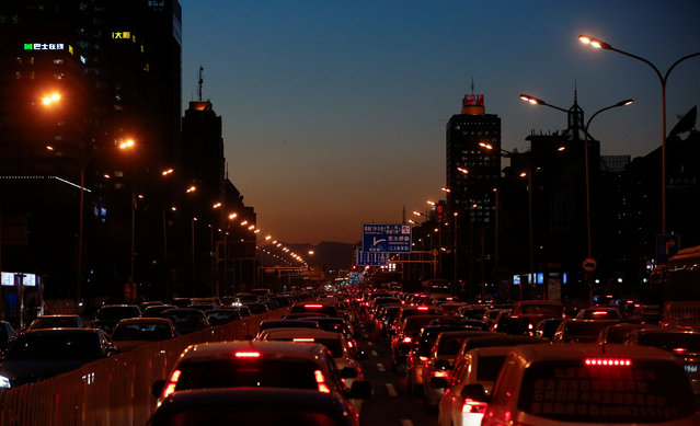 Cars stand bumper to bumper in the evening rush hour traffic jam in central Beijing, China, December 8, 2016. (Photo by Thomas Peter/Reuters)