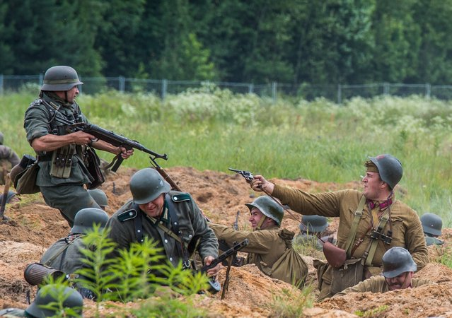 "Military history enthusiasts dressed as Nazi Germany and Soviet Red Army troops take part in a staged ""Summer 1941"" battle near Ivanovskoye, Russia. (Photo by Dmitry Serebryakov/AFP Photo)"
