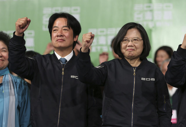 Taiwan's 2020 presidential election candidate, Taiwanese President Tsai Ing-wen, right, and her running mate William Lai celebrate their victory with supporters in Taipei, Taiwan, Saturday, January 11, 2020. Taiwan's independence-leaning President Tsai Ing-wen won a second term in a landslide election victory Saturday, signaling strong support for her tough stance against China. (Photo by Chiang Ying-ying/AP Photo)