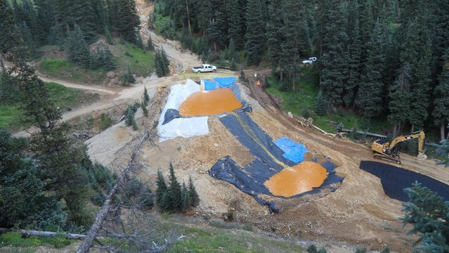 Yellow mine waste water from the Gold King Mine collects in holding pools in San Juan County, Colorado, is seen in this picture released by the Environmental Protection Agency (EPA) taken August 7, 2015. (Photo by Reuters/EPA)