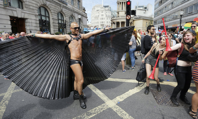 Revelers enjoy the Pride London Parade in London, Saturday, July 8, 2017. The parade attracts an estimated crowd of 1 million people, while around 26,500 people are taking part in the annual Parade making this the city's biggest one-day event and one of the world's biggest LGBT+ celebrations. (Photo by Frank Augstein/AP Photo)